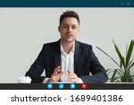 Small photo of Headshot portrait screen application view of male employee have online interview using Web conference on computer, young businessman speak talk on video call on laptop with partner from home