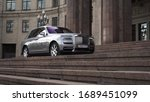 Small photo of Moscow, Russia - 13 03 2020: The majestic Rolls Royce Cullinan in his path. expensive car drove up to the palace with huge columns and stands waiting for the businessman.