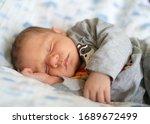 Little Baby Sleeps Happily On...