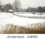 This a snow landscape taken at Holmdel State Park in New Jersey with a watercolor painting effect. - stock photo
