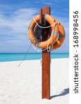alert sign in white sand and... | Shutterstock . vector #168998456