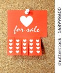 Red paper add with Heart for sale text pinned to the corkboard - stock photo