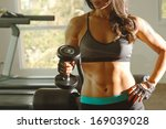 torso of a young fit woman... | Shutterstock . vector #169039028