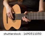 Female Hands With A Guitar...