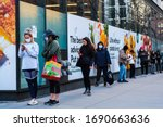 Small photo of NEW YORK, NEW YORK - APRIL 01, 2020: A long line outside of Whole Foods in Tribeca, New York as the store has implemented social distancing measures during the COVID-19 pandemic.
