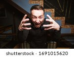 the face of a man with emotions.... | Shutterstock . vector #1691015620