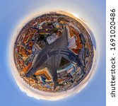 Little planet angular fisheye panorama of Bratislava old town, Slovakia from above. Full 360 degree aerial tiny planet photo of cityscape at sunset with Castle, Presidential palace and other landmarks