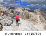 mountaineer on the trail to... | Shutterstock . vector #169107506