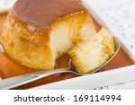 Pudim de Leite - Brazilian flan made with milk and condensed milk, topped with caramel sauce. - stock photo