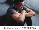 Depressed African American Man...