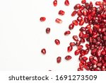 pomegranate seeds on a white background - stock photo