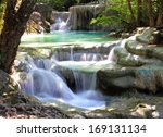 beautiful waterfall at erawan... | Shutterstock . vector #169131134