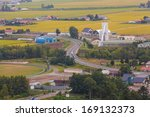 a rural road to a farm in... | Shutterstock . vector #169132373