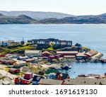 Harbour and homes in Qaqortoq, located in the Kujalleq municipality in Southern Greenland, located near Cape Thorvaldsen.