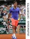 Small photo of PARIS, FRANCE - MAY 24, 2015: Seventeen times Grand Slam champion Roger Federer of Switzerland in action during his first round match at 2015 Roland Garros in Paris, France