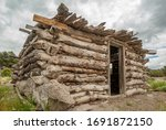 A Rustic Log Cabin Made From...