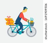 courier on a bicycle. cartoon... | Shutterstock .eps vector #1691909506