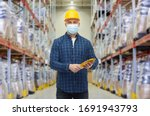 Small photo of wholesale, logistic, people and export concept - male worker in safety helmet wearing face protective medical mask over warehouse background
