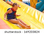 Enthusiastic Children On Slide...