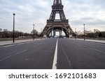 Small photo of Paris, France - March 30 2020: Empty Iena bridge in front of Eiffel Tower during Coronavirus Lockdown in Paris.