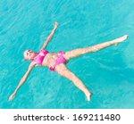 in pink bikini blonde woman    Shutterstock . vector #169211480