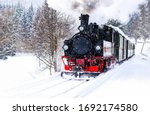 Steam train rushes through the...