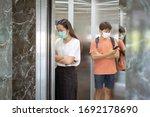 social distancing in an elevator   Shutterstock . vector #1692178690