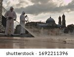 Two Municipal Workers In...