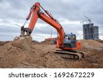 Red Excavator During Earthworks ...