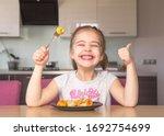 Little Girl Eats Colorful...