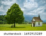 Bench under the tree close to small chapel near Wichelsee close to Sarnen in Switzerland. Just to sit and relax