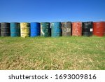 Colorful Old Oil Drums On The...