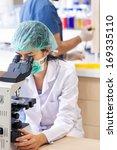 female lab technician sitting... | Shutterstock . vector #169335110