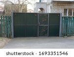 Closed Iron Green Gate With...