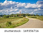 Beautiful green village  scenery landscape in spring time under cloudy sky, Mali Raven, Croatia - stock photo