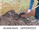 Gardener Shovelling Homemade...