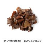 Wet black fungus, tree ear or wood ear mushroom isolated on white background top view. Soaked dry auricularia polytricha also known as cloud ear, black mushroom, jelly fungus or cloud ear fungus