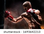 Kickboxer Punches The Bag....