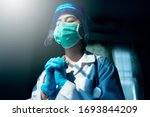 Doctor in ppe suit uniform has...