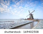 Dutch Windmill In Winter Over...