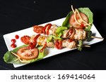 skewers with vegetables and meat | Shutterstock . vector #169414064