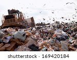 truck working in landfill with... | Shutterstock . vector #169420184