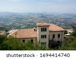 Panorama of isolated Italian hillside extensive landscape from the Monte Titano ridge of the capital of San Marino and a historic buildign of the Republic of San Marino