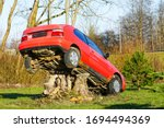 A Red Car Placed On A Large...
