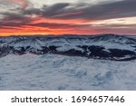 Small photo of Sun rising in the east over the Rocky Mountains, seen from the summit of Quandary Peak, winter time, Breckenridge, Colorado