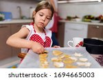 Young Girl Making Gingerbread...