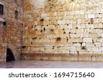 Small photo of The Western Wailing Wall Kotel Empty in Jerusalem old city, Israel.The Wall is the holiest place where Jews are permitted to pray, though the holiest site in the Jewish faith lies behind it.