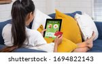 asian woman order food online... | Shutterstock . vector #1694822143