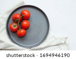 Tomatoes On A Branch On A Plate ...