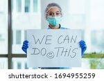 Healthcare worker holding...